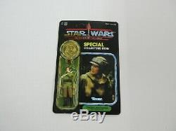 VINTAGE 1984 KENNER STAR WARS POTF LEIA COMBAT PONCHO FIGURE With COIN SEALED RARE